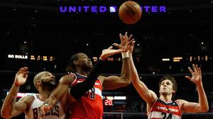 Washington Wizards' Jason Collins and Wizards' Jan Vesely battle for a rebound against Chicago Bulls' Carlos Boozer in Chicago, Illinois